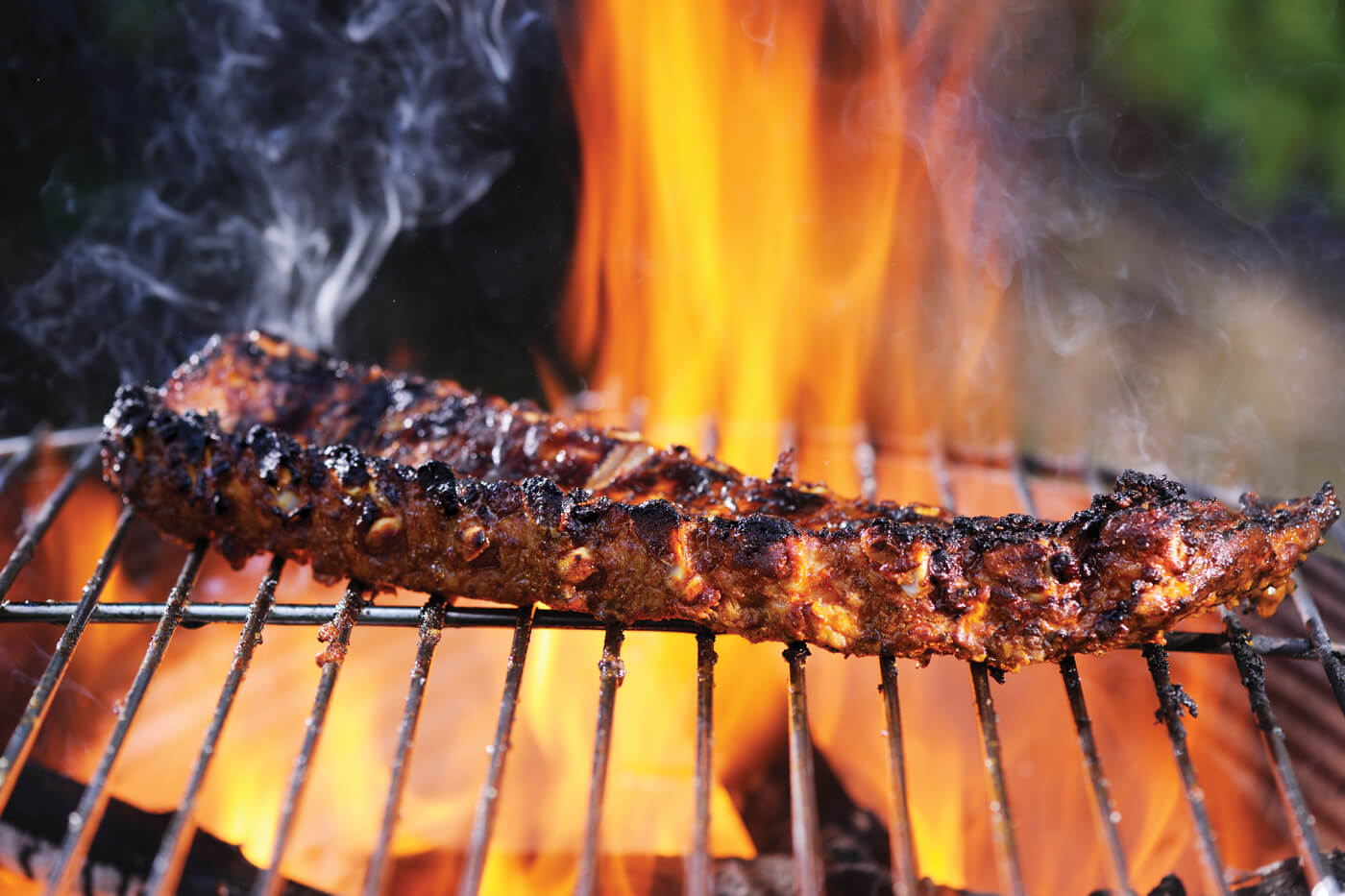 Creating a two- zone grilling area is crucial to keeping your meat at a good temperature.