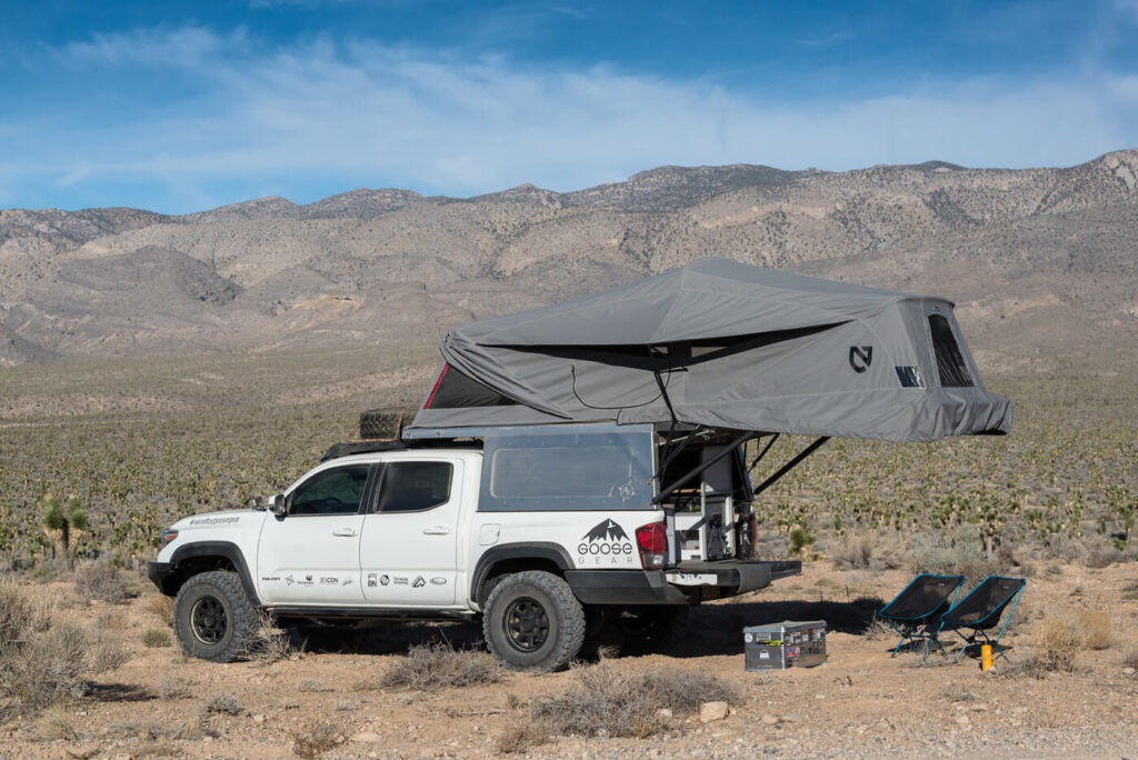 A full living-quarters system designed specifically to work on a Toyota Tacoma outfitted with an AT Overland Habitat bed-mounted shell.
