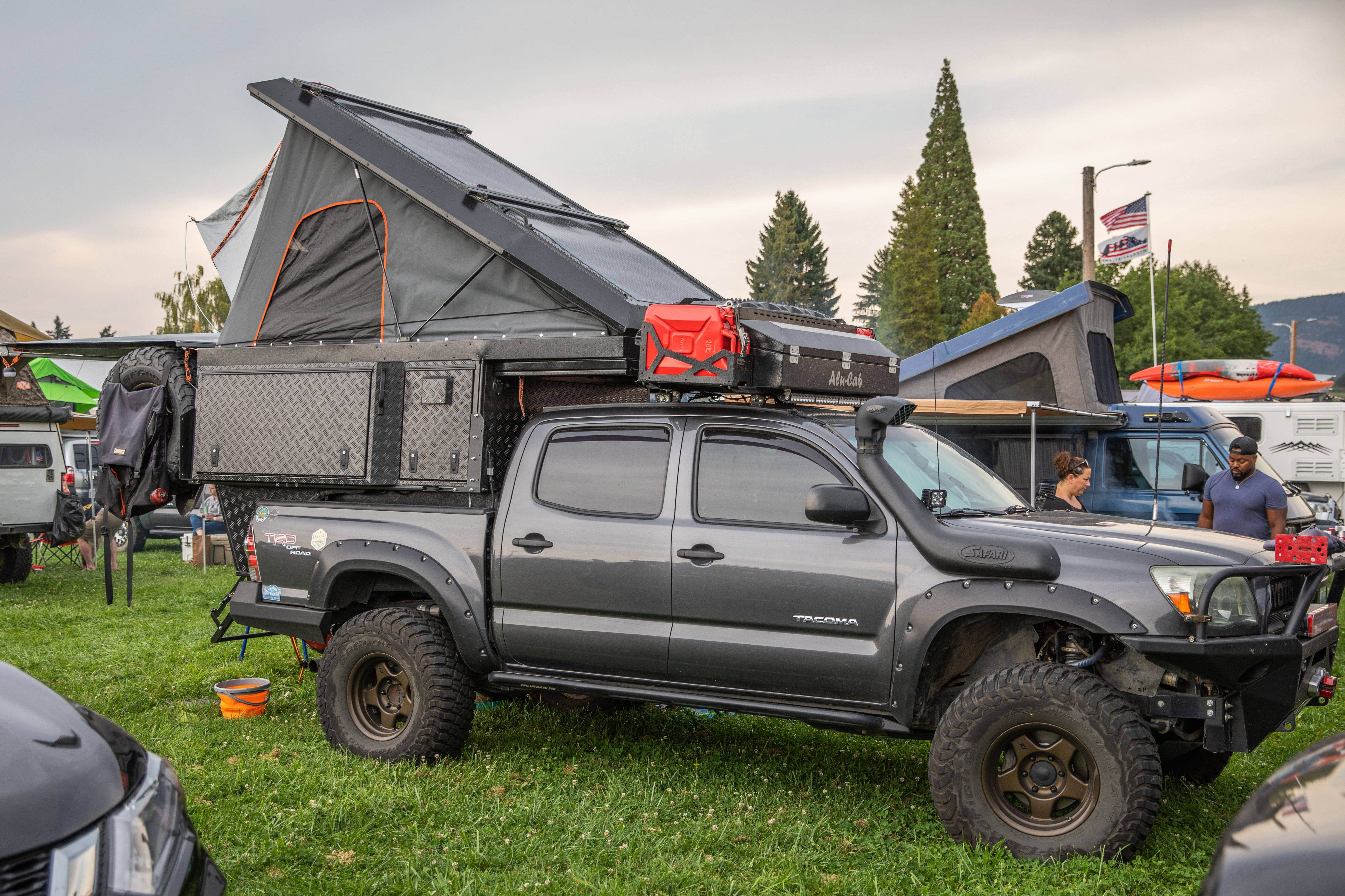 Toyo Tires Trailpass: Gray Toyota Tacoma with Alu-Cab Khaya tent and camper