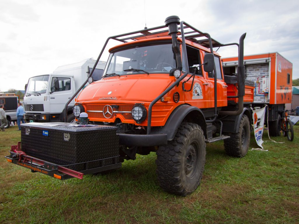 2019 Overland Expo East: 1979 four-door Unimog with home-built trailer using a Schutt Industries M1102 military trailer base and living quarters on top.