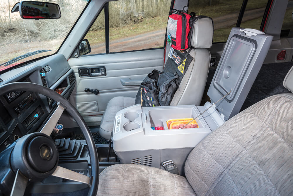 A Dometic fridge/freezer is installed between the seats