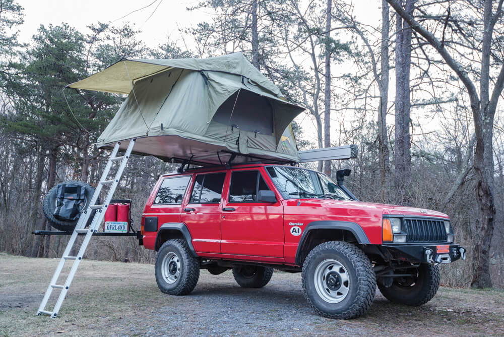 Jeep Cherokee XJ with roof top tent ready for camping