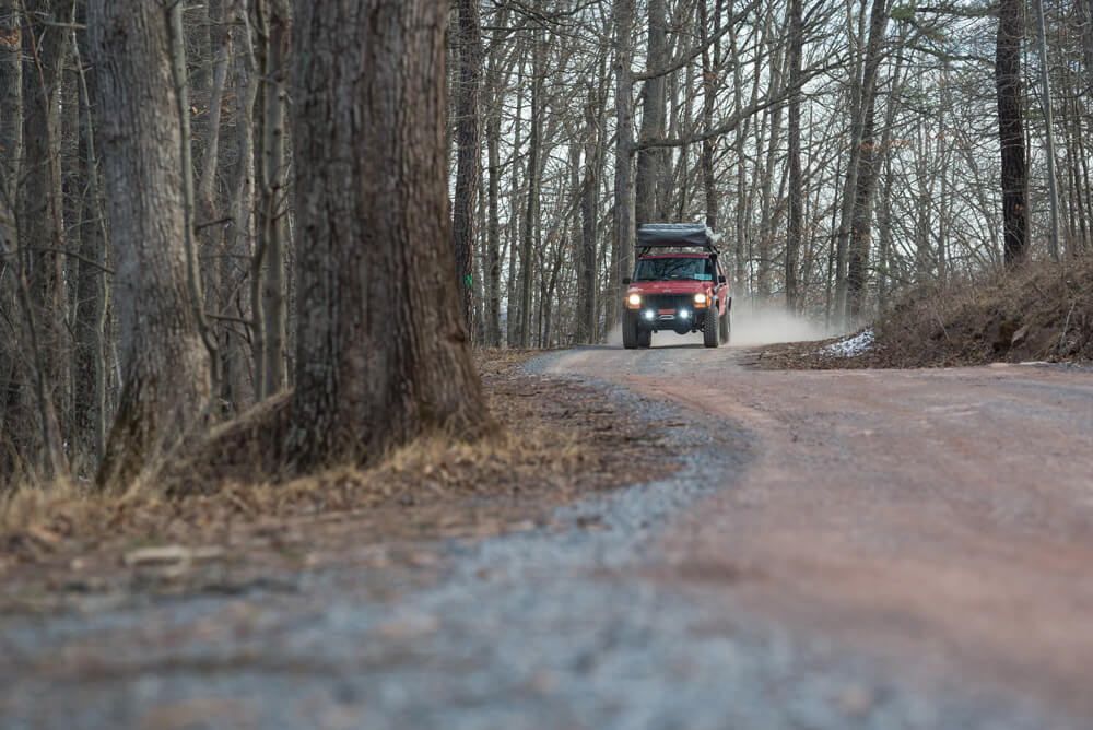 Jeep Cherokee XJ driving in the woods