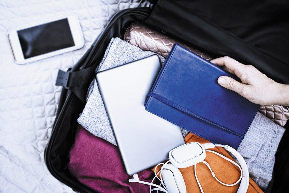 One-Bag Travel Clothes Headphones Book iPad