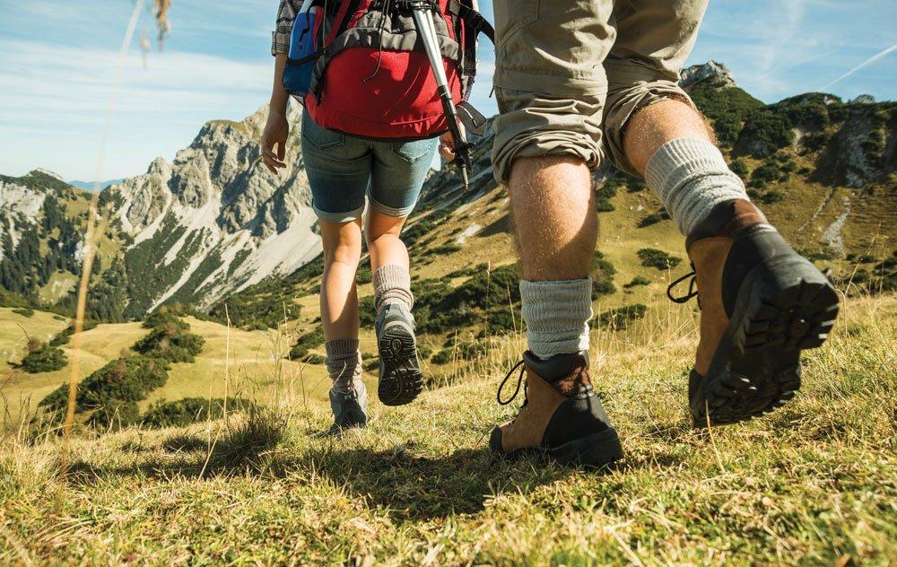 Two people walking downhill