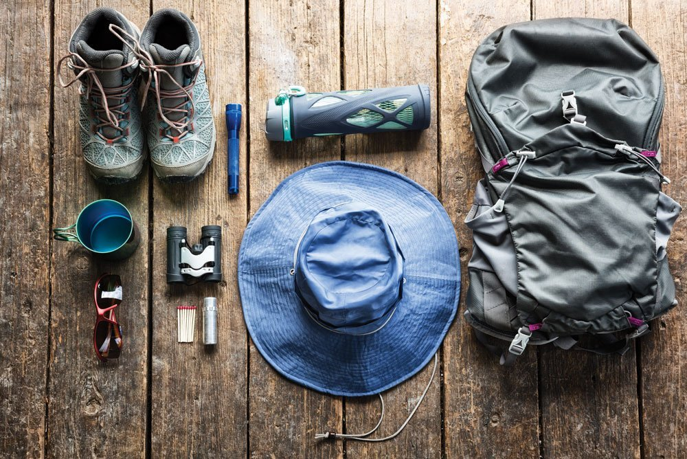 Shoes, cup, flashlight, binoculars, sunglasses, matches, hat, go-bag