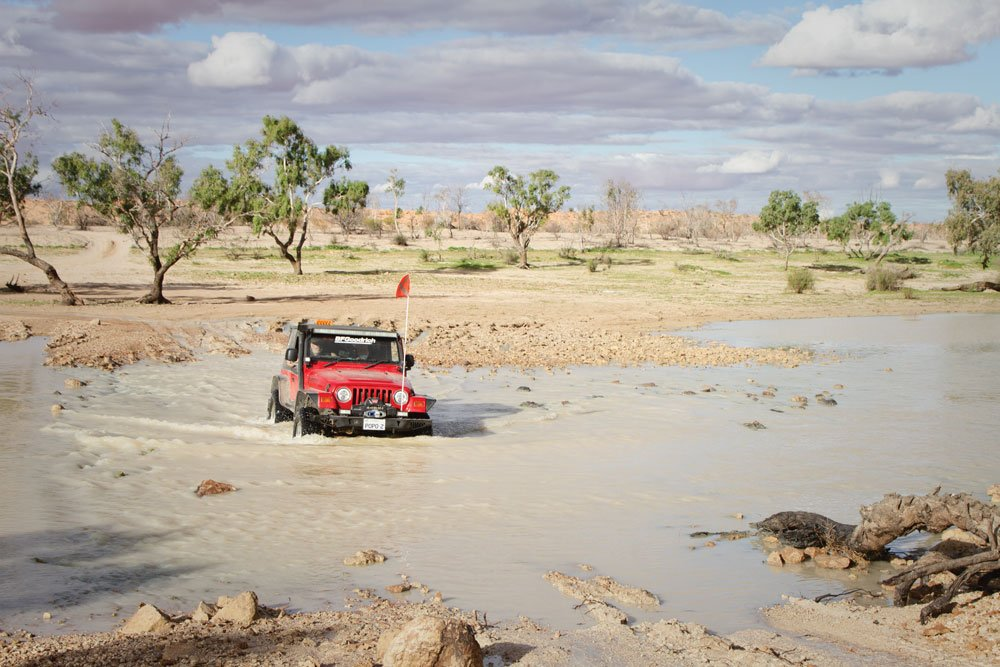 Jeep traveling through muddy water Australia