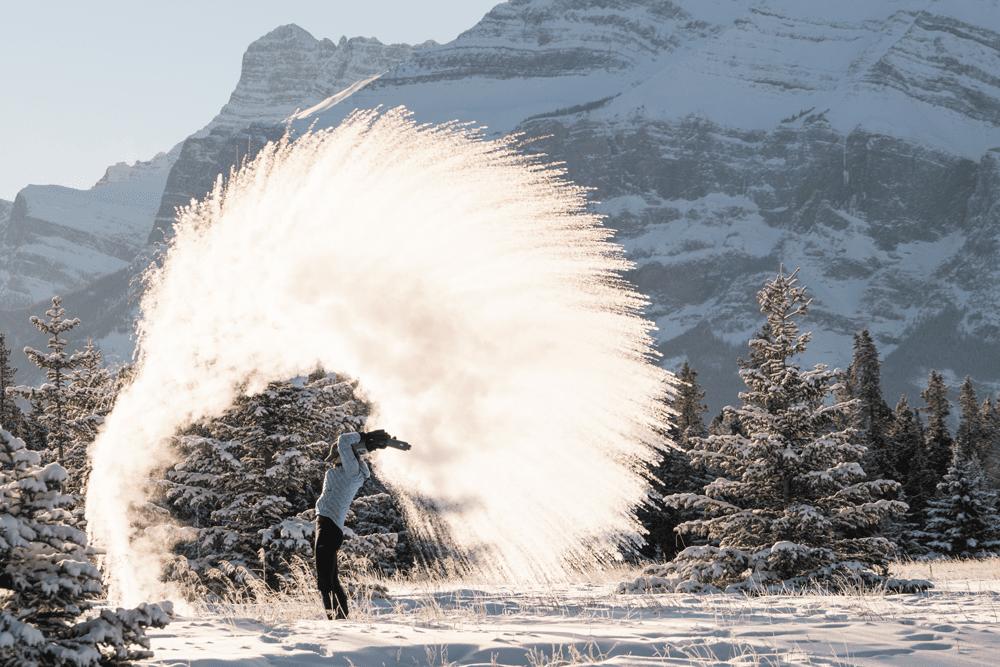 Lisa Morris tosses snow in Alberta, Canada