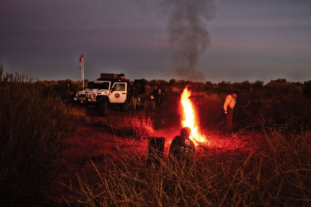 Jeep Convoy camps in Australian night with fire