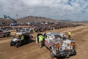The trucks are lined up at the start and safety gets set at 2020 Mint 400.