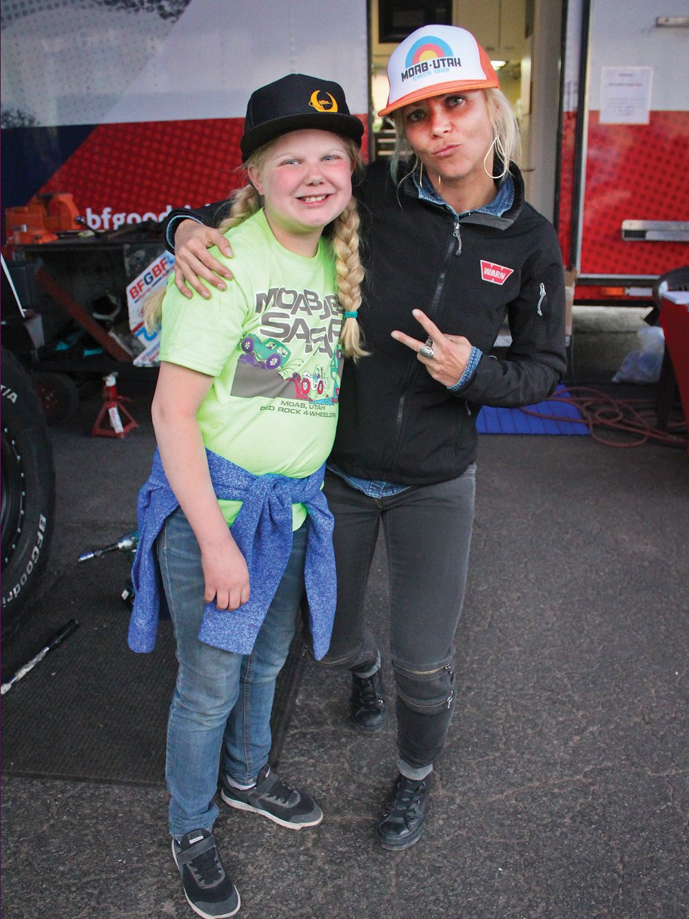 Jessi Combs poses with young girl