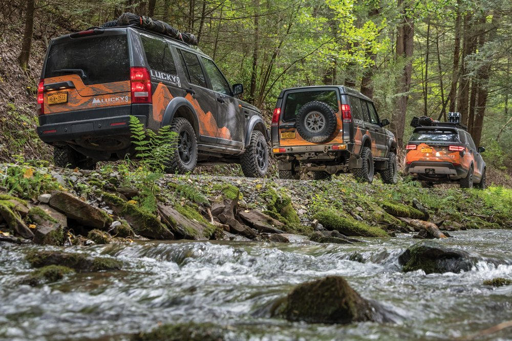 Land Rover Discoveries driving