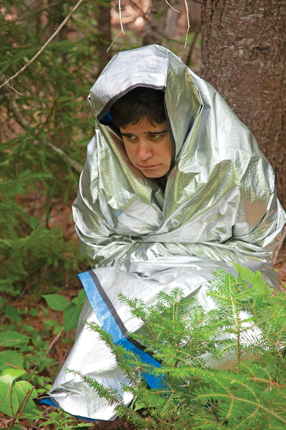 Lost in the woods using an emergency blanket