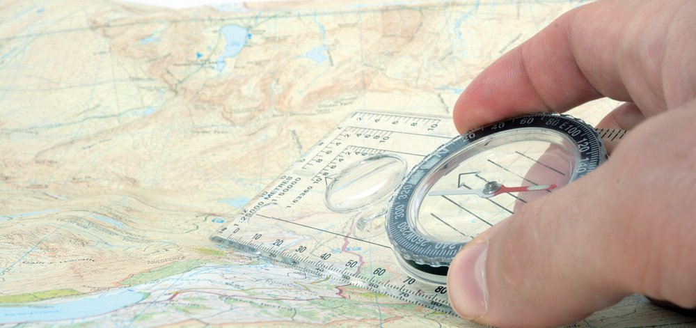 compass and map for backcountry navigation