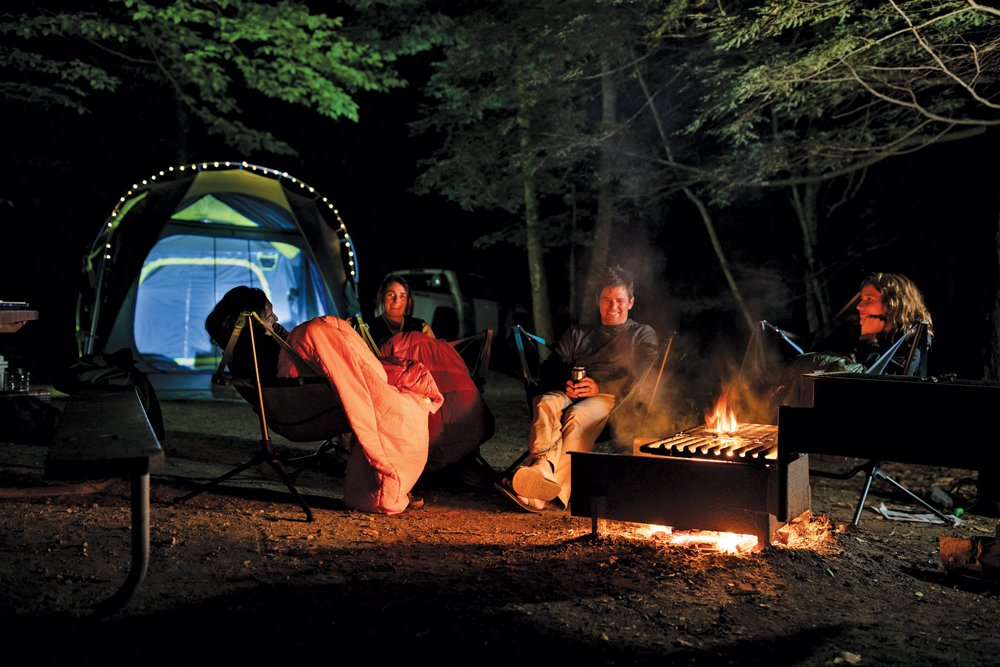 cold weather gear using technical blanket by campfire