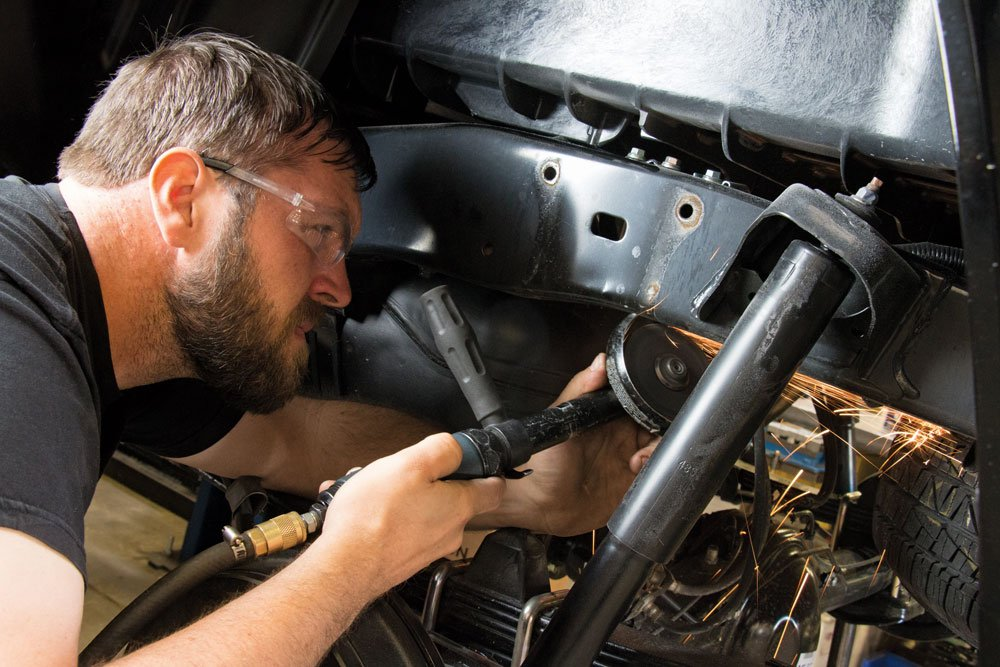 Man working on a suspension