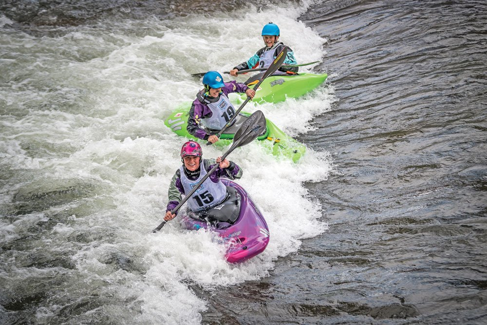 group surfing a kayak