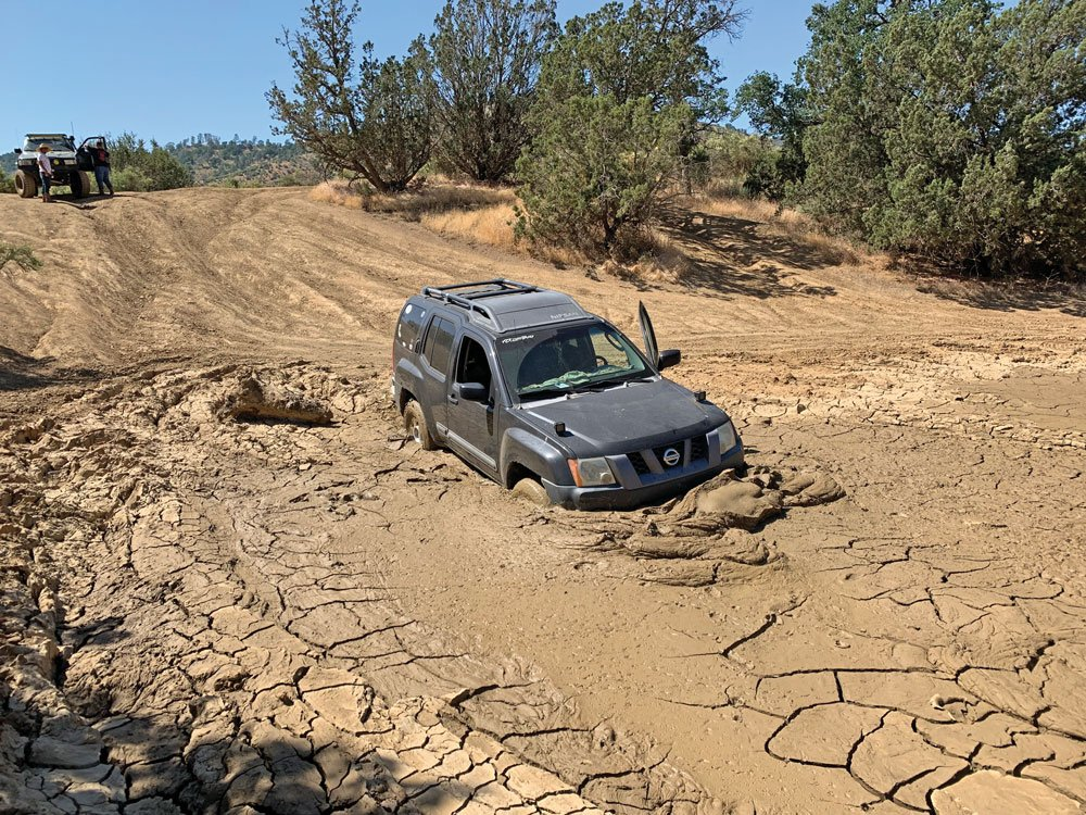 Nissan stuck on the trail