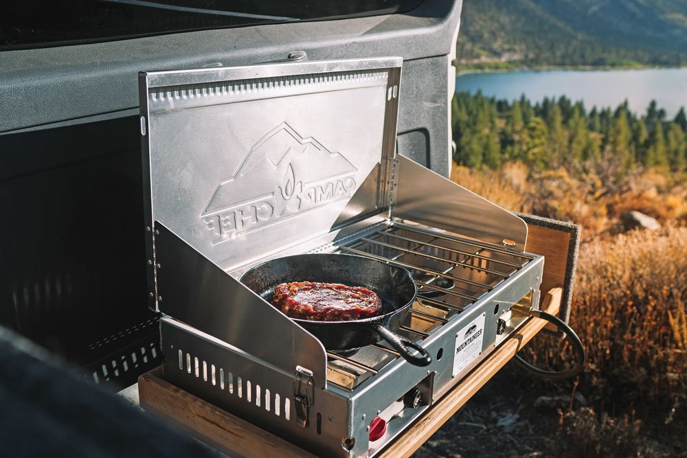 Camp Chef Mountaineer with steak cooking on it