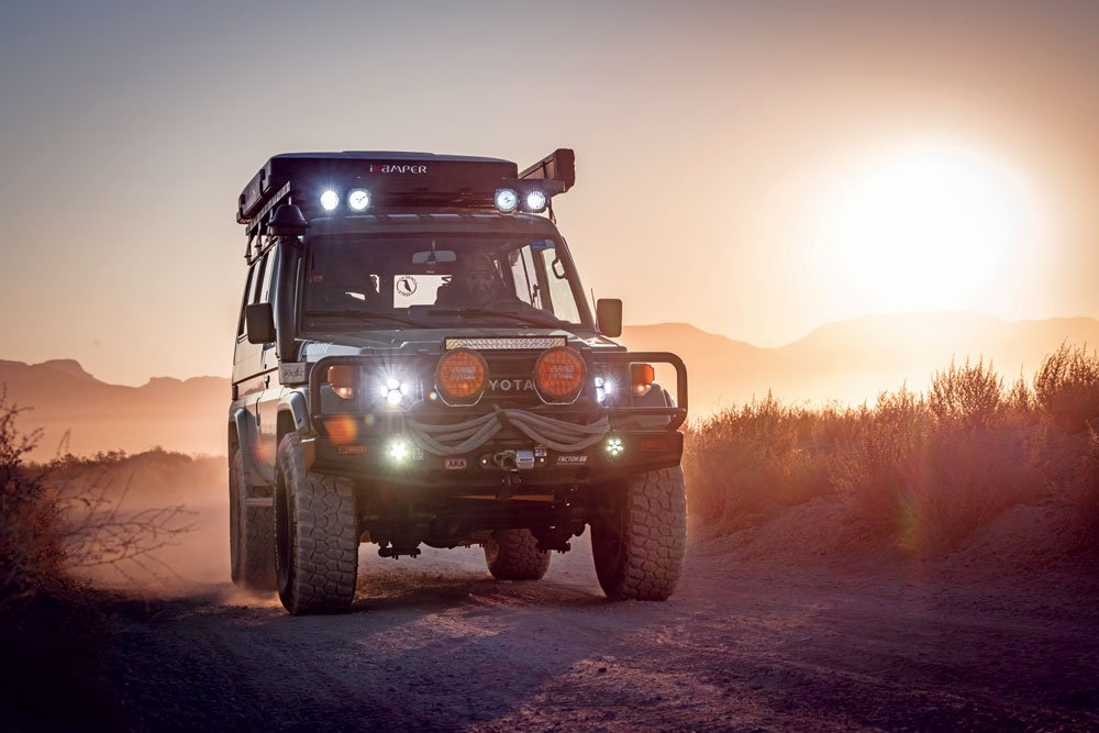 1985 Toyota Land Cruiser Troopy driving at sunset