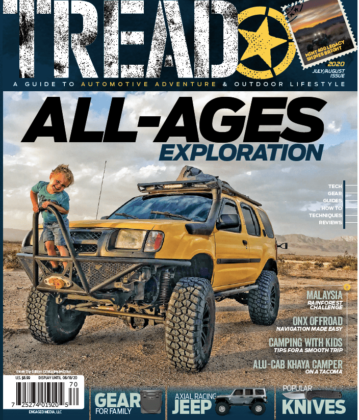 Tread Cover with yellow Nissan Xterra with young boy on bumper