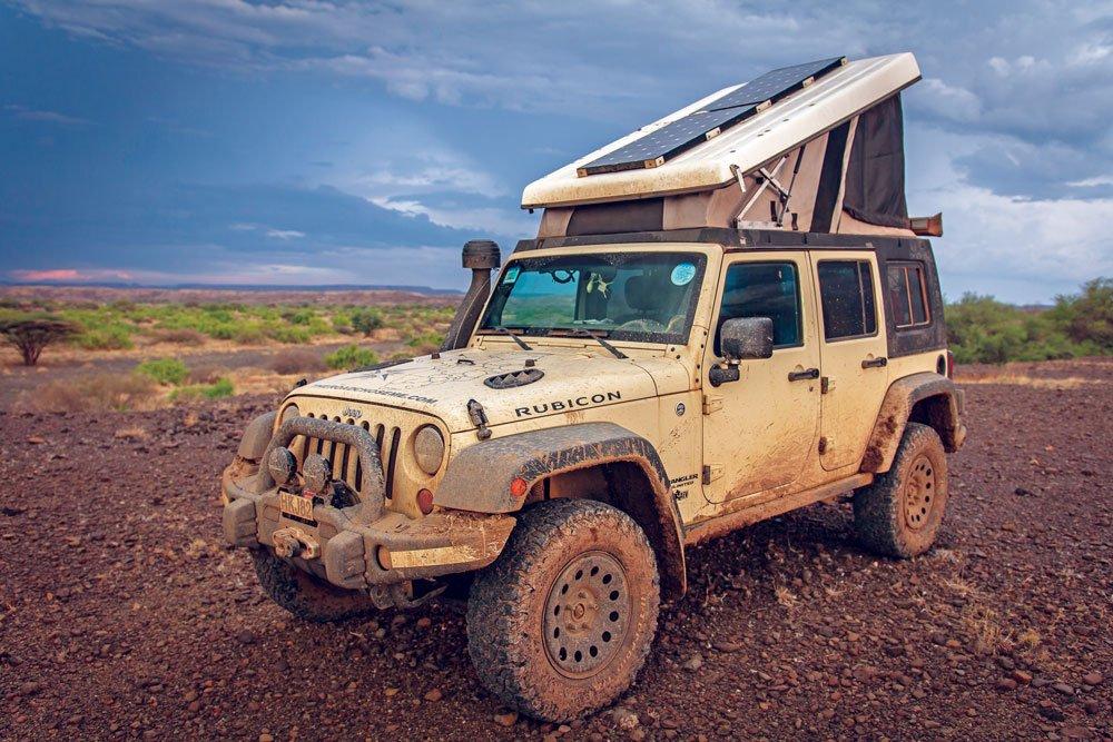 Messy Jeep traveling muddy tracks in Kenya