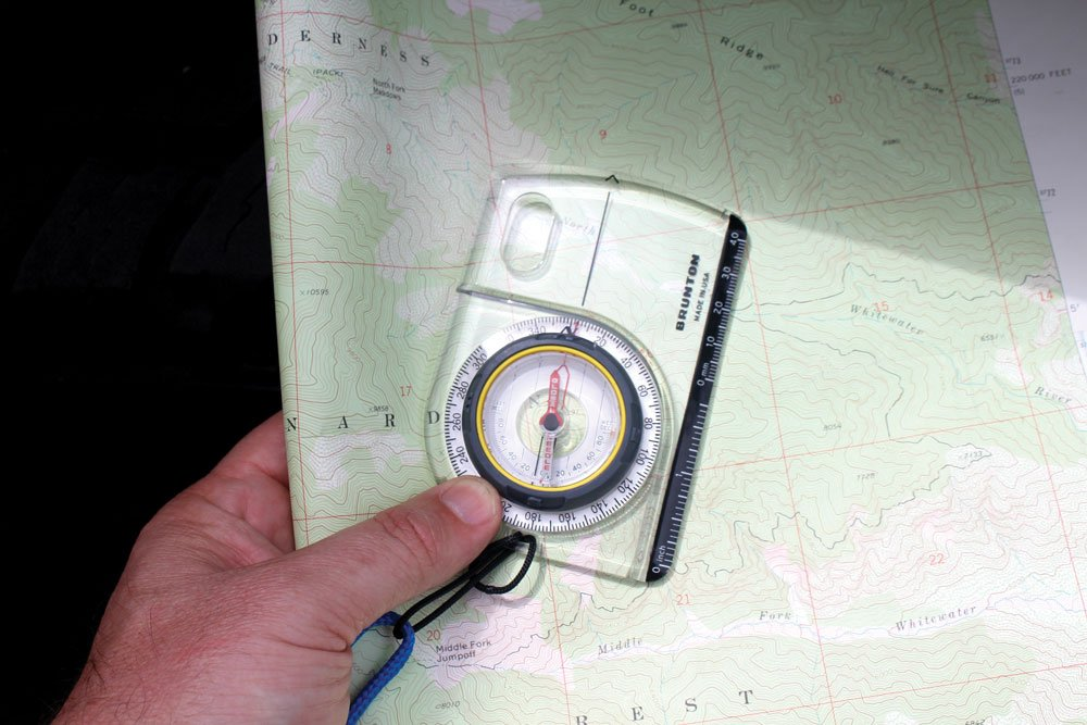 Orienting a compass to a map