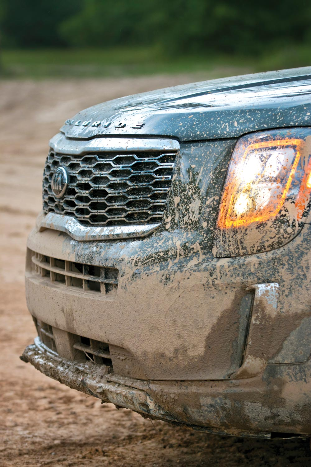 muddy front bumper and grille
