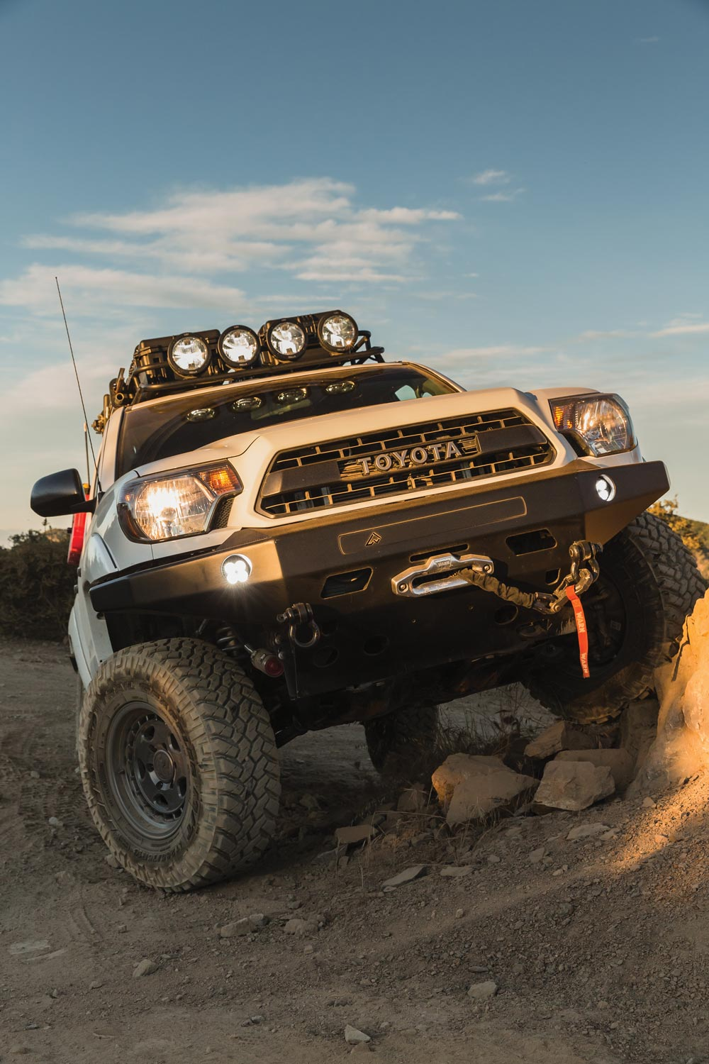 Pelfreybilt aluminum front bumper houses Hella Micro 70 LED lights, Warn winch, Epic winch hook