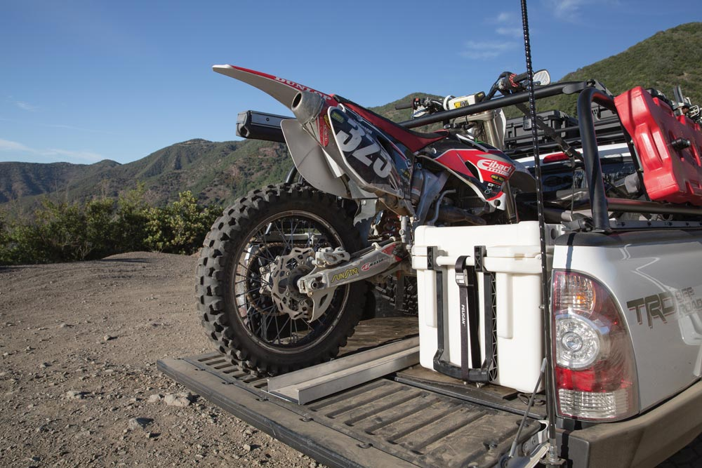 Tacoma truck bed hauling a motorcycle