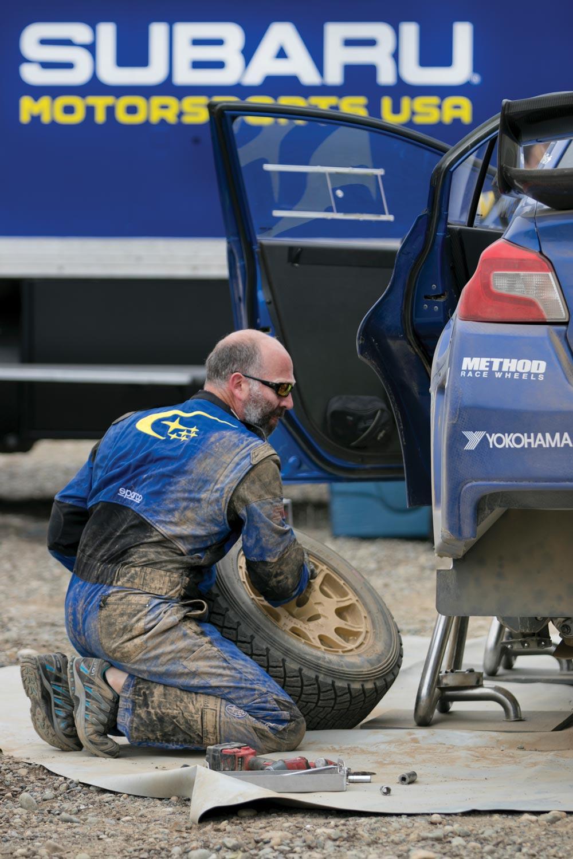 Subaru's Graham Price working on Higgins' car