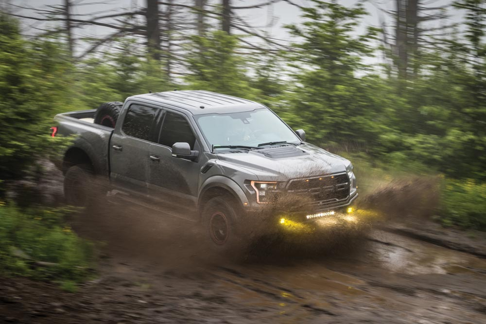 2018 Ford Raptor Supercrew driving in the mud