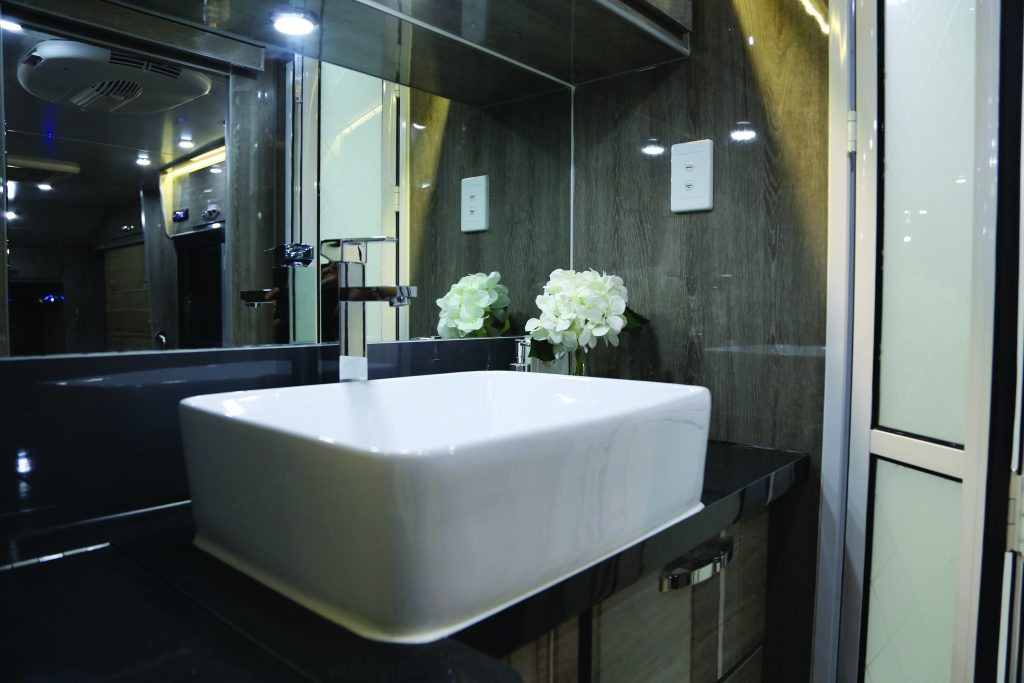 The bathroom includes a separate toilet and shower