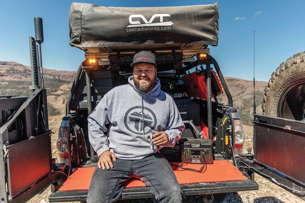 Ken Hoglund sits on the tailgate of his truck