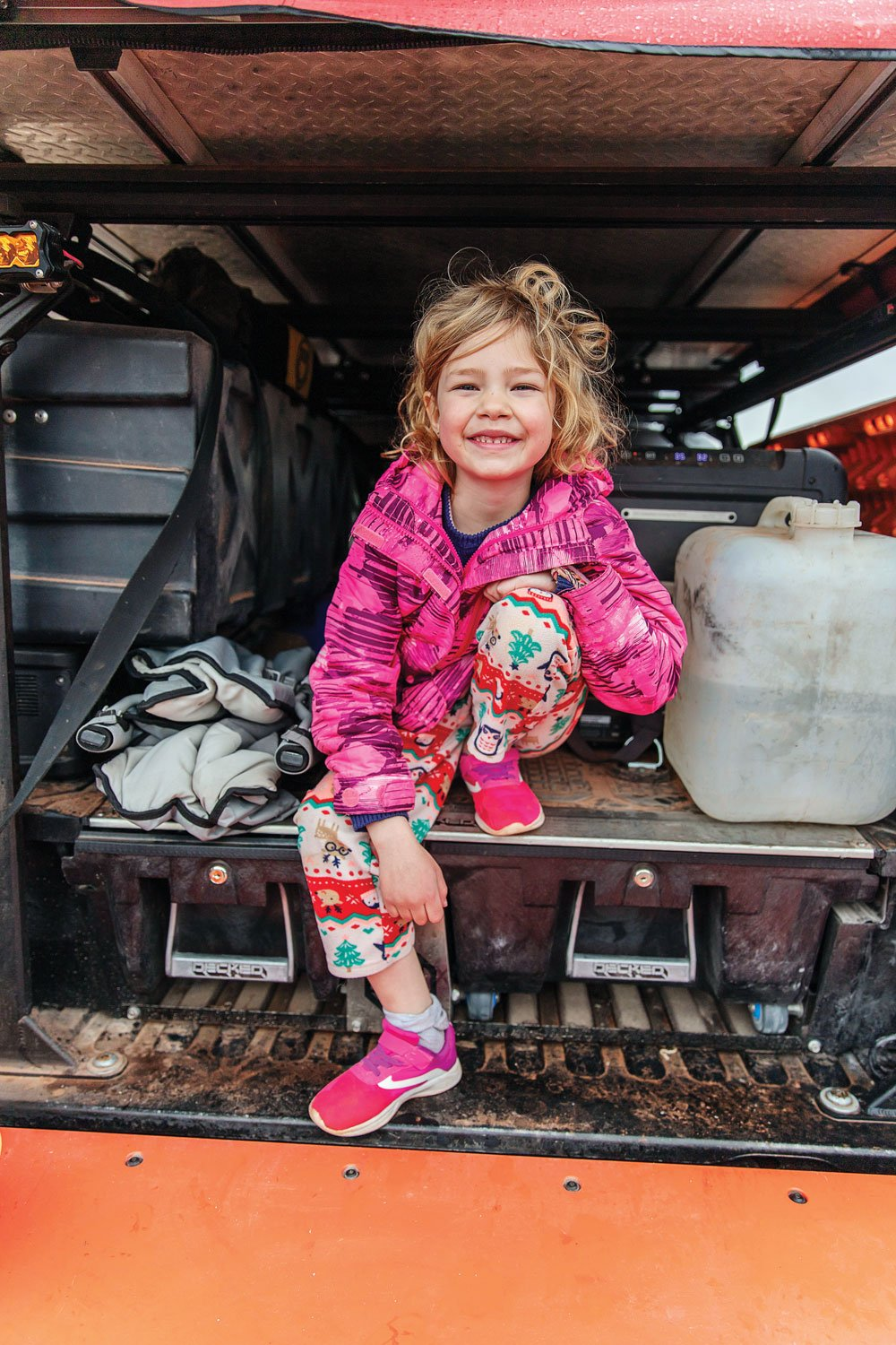 Hoglund's daughter sits in the back of the Tacoma TRD