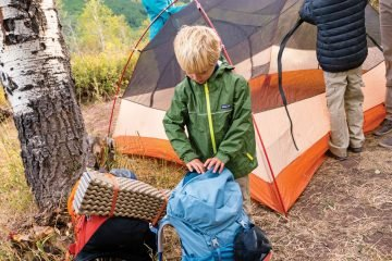 Putting the camping tent together as family