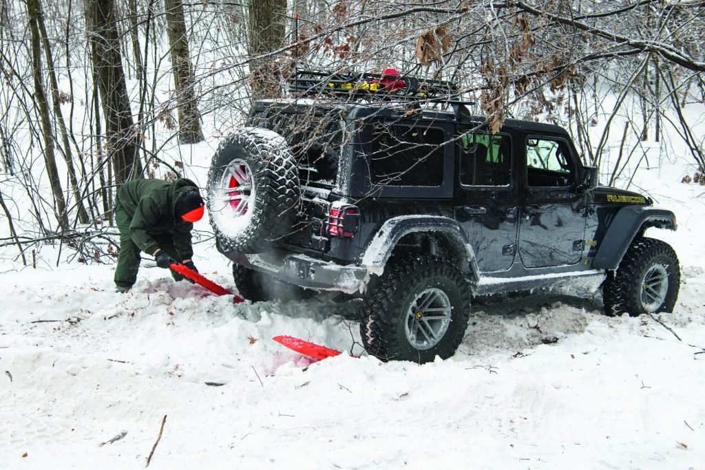 Using recovery boards to get the vehicle out of the snow