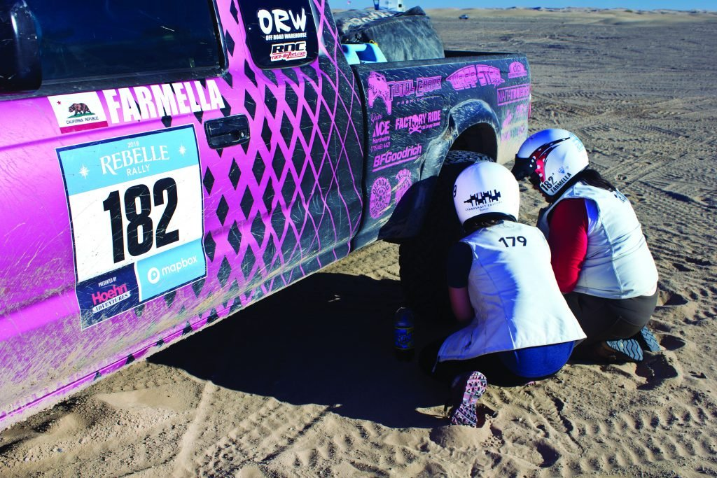 Women tag-team together to deflate tires