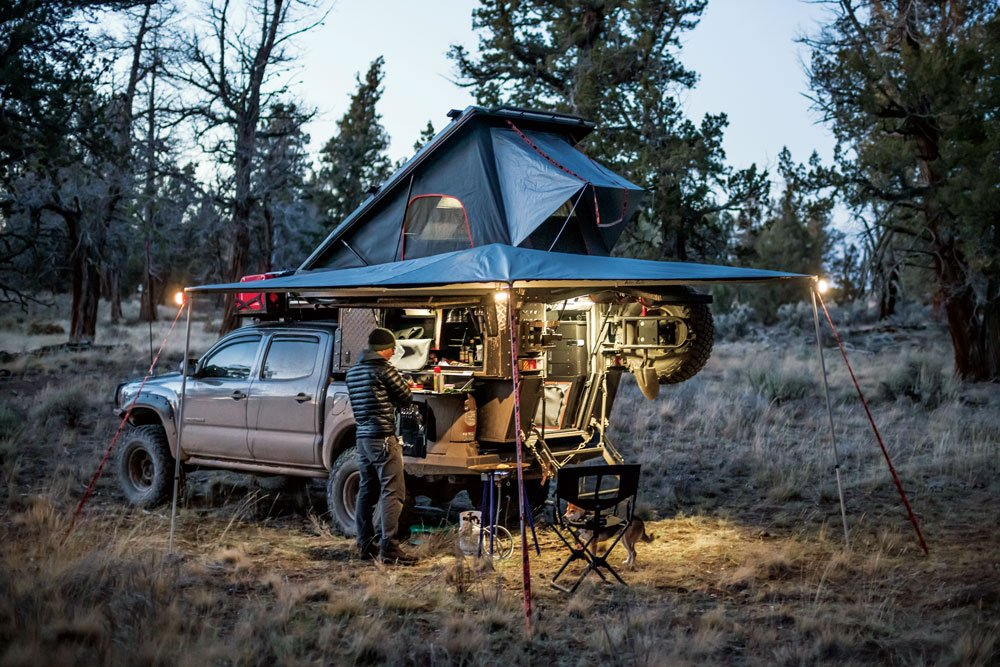 Enjoying a hot meal under the Tacoma and Khaya Camper