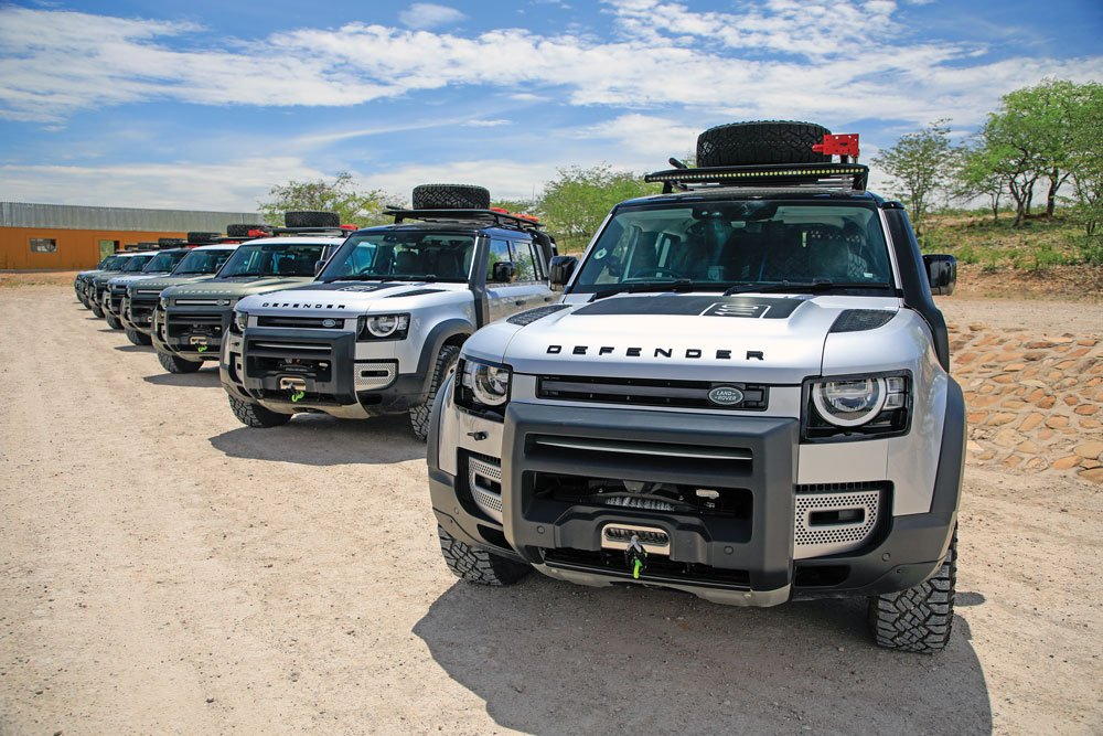 Land Rover Defenders lined up waiting for drivers