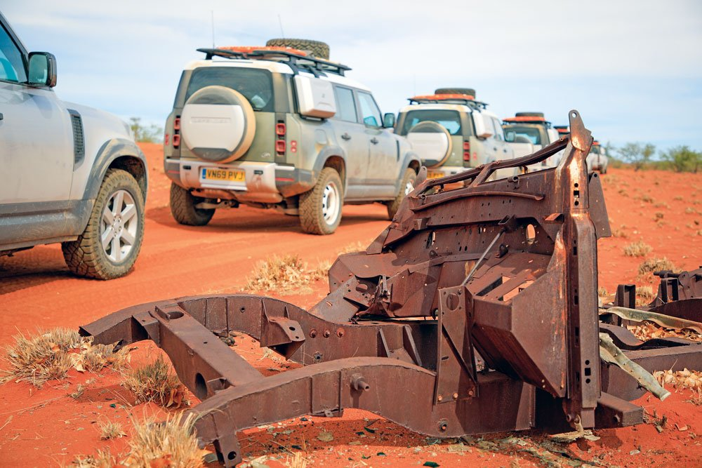Rusted chassis left on the side of the road