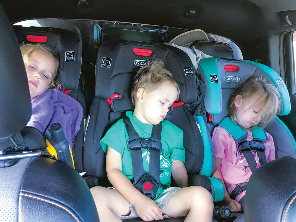 Travel with kids tip: Three car seats easily fit in the back of an SUV