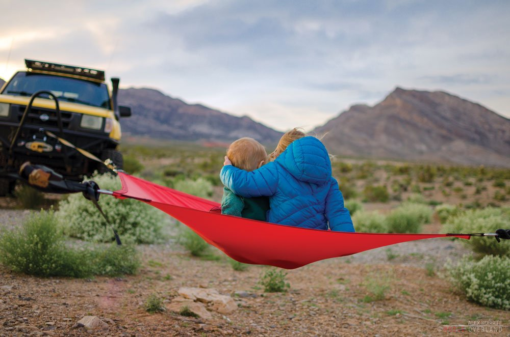 Two kids on a hammock at the campground