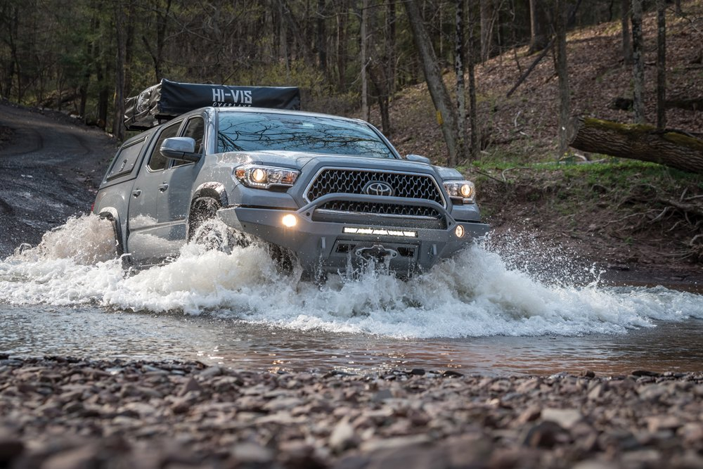 Toyota Tacoma driving through shallow water