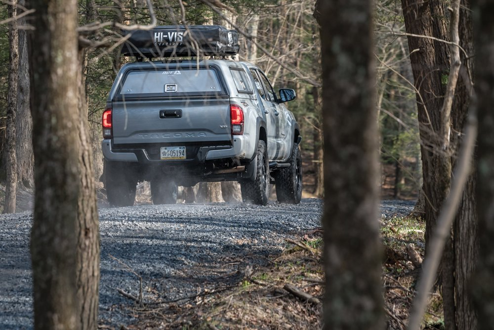 Rearview of the Tacoma driving down a gravel road