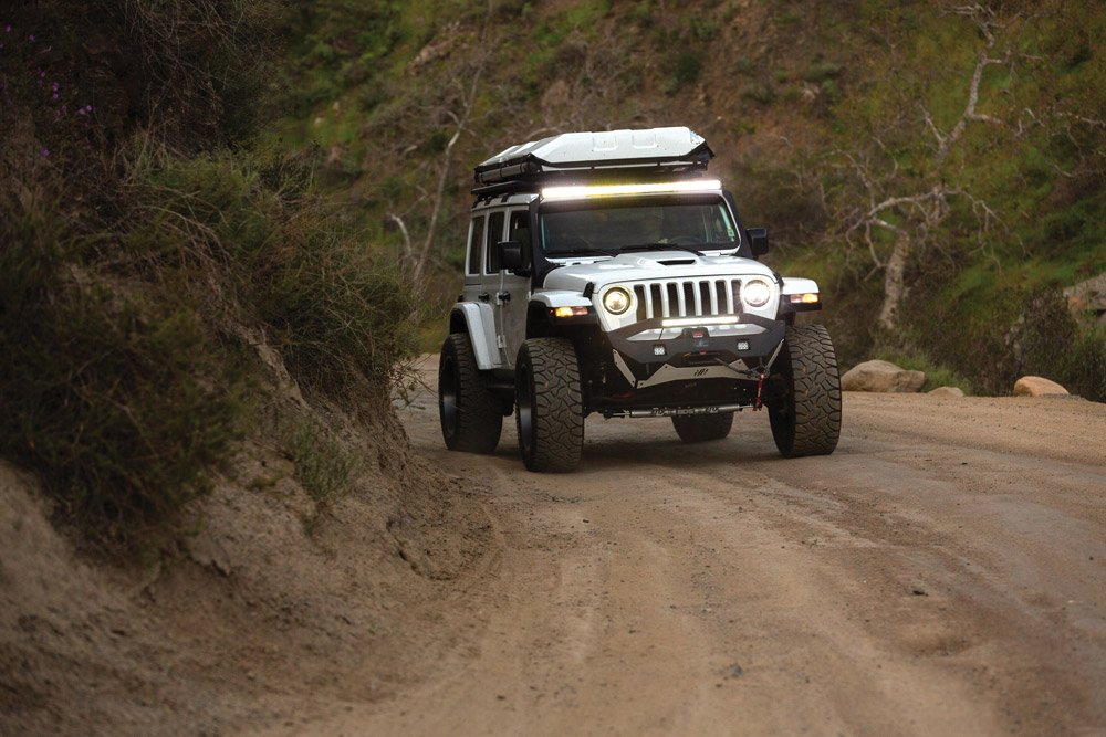 Driving shot of the Jeep on a dirt road