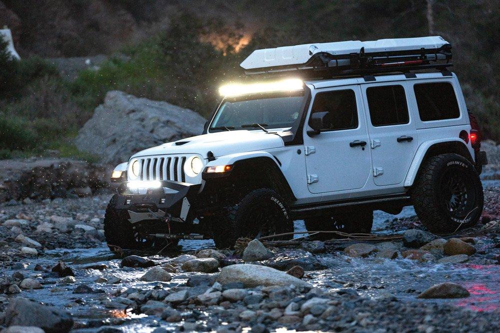 2018 Jeep Wrangler JLU near a creek