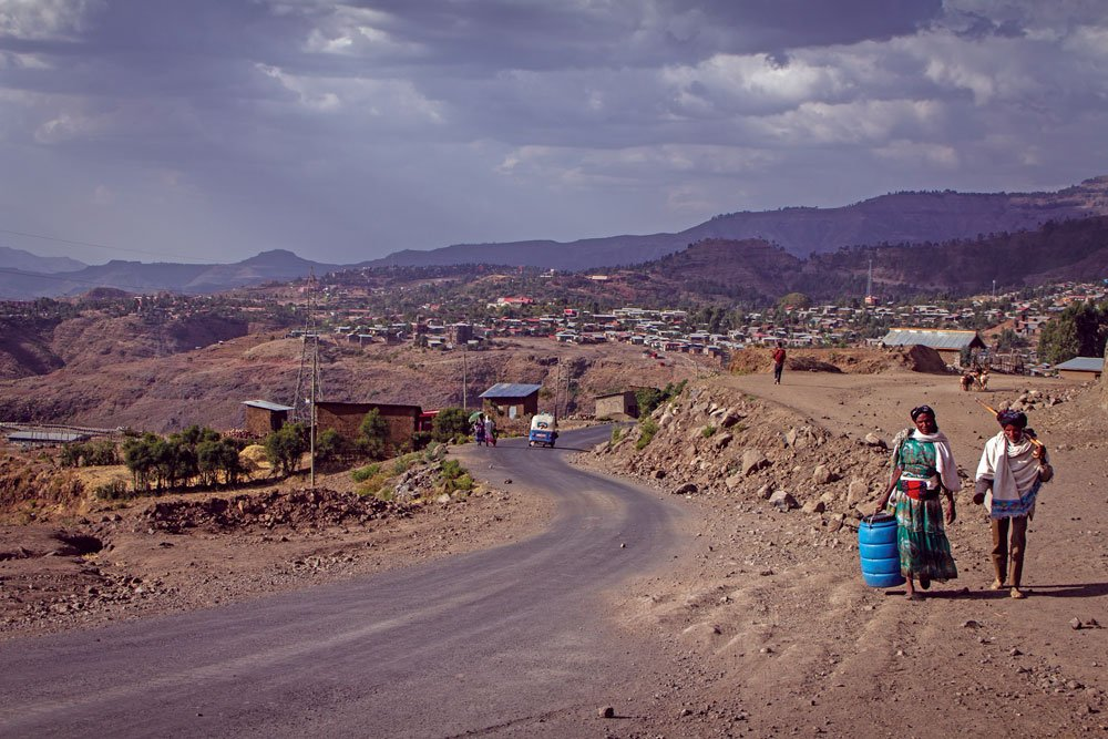 Villagers in Ethiopia are seen carrying containers to get water