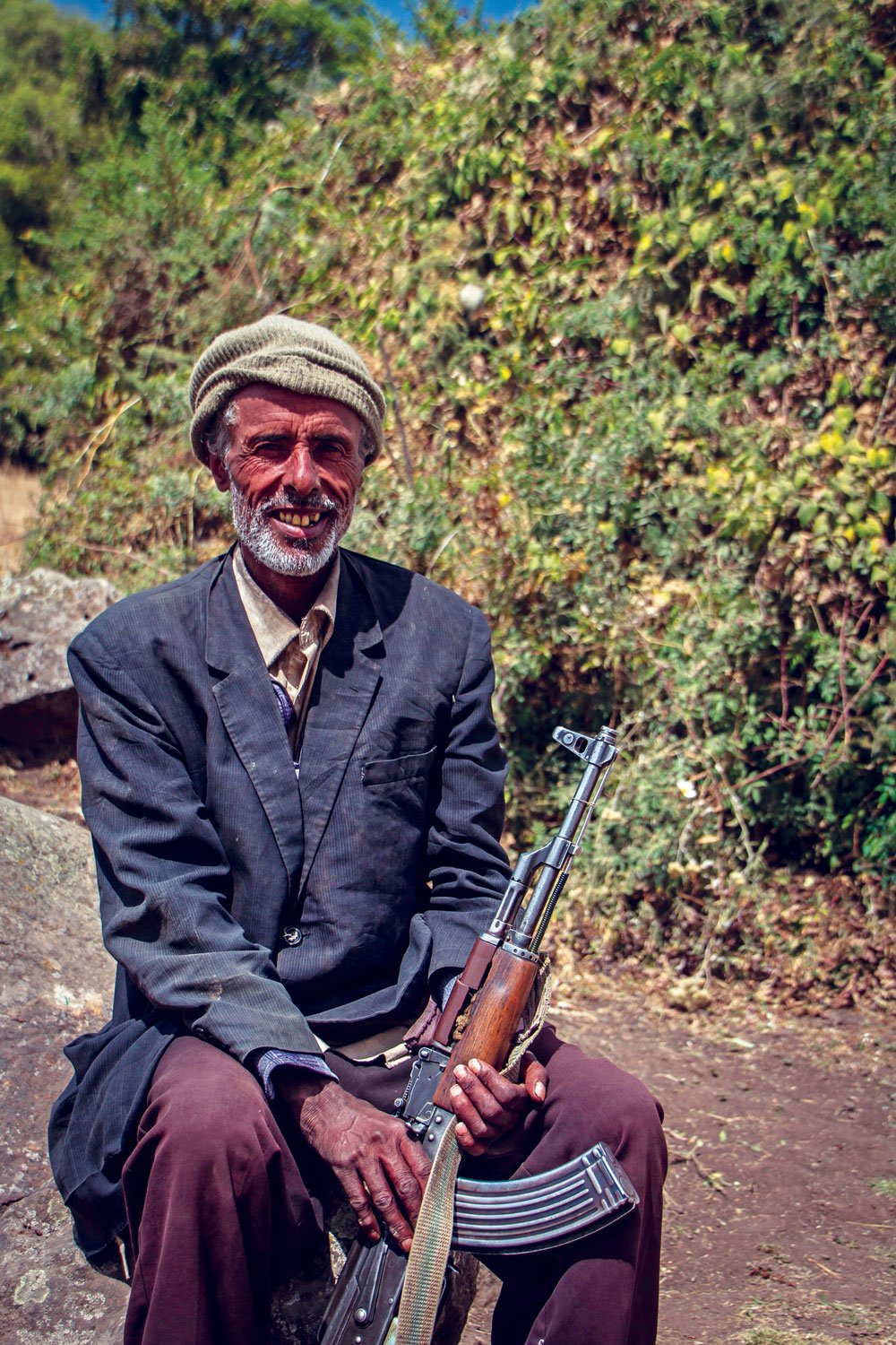 The Simien scout with his AK-47 bearing a smile