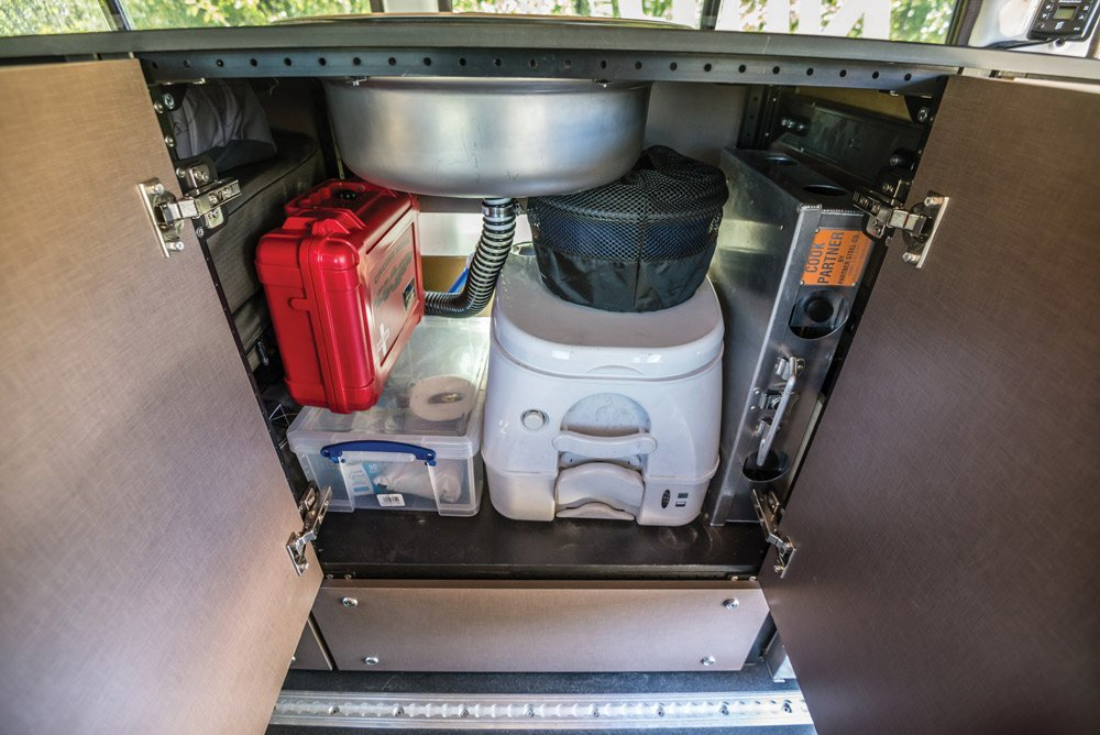This overland rig includes a kitchen sink, stove and toilet